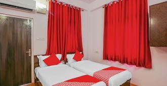 OYO 17168 Hz 旅馆 - 海得拉巴 - 睡房