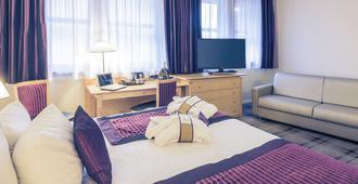 美居旅游中心会议中心酒店 - 图尔 - 睡房