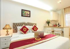金西贡酒店 - 胡志明市 - 睡房