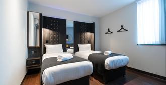 利物浦街Tune酒店 - 伦敦 - 睡房