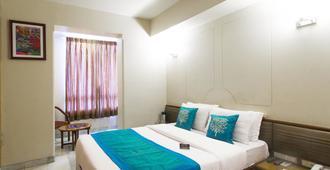阿什瑞伊国际酒店 - 孟买 - 睡房