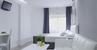 猎户座公寓酒店 - 马德里 - 睡房