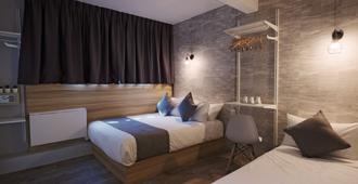Q阁楼酒店@勿洛 - 新加坡 - 睡房