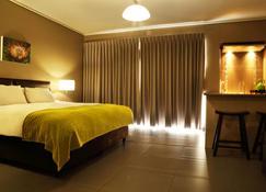 迪亚兹朴桃酒店 - 莫塞尔湾 - 睡房