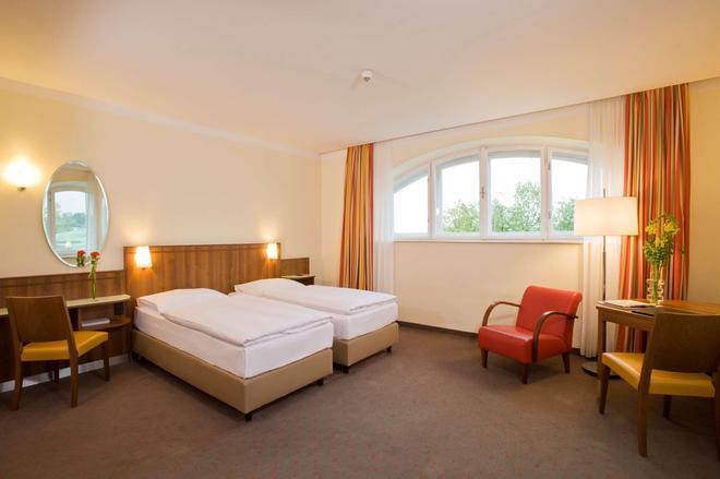 维也纳贝尔韦代雷nh酒店 - 维也纳 - 睡房