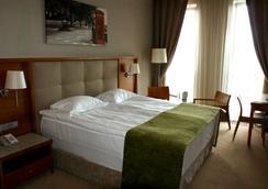 城市酒店 - 基辅 - 睡房