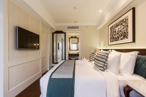 巴厘沙努尔奥利亚酒店 - 登巴萨 - 睡房