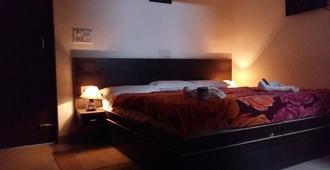 萨法里酒店 - 阿格拉 - 睡房