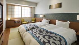 艾我诗阪急宾馆 - 东京 - 睡房