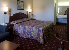 马斯科吉美洲最佳价值酒店 - 马斯科吉 - 睡房