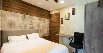 孟买客房安德赫里酒店 - 米迪克 - 孟买 - 睡房