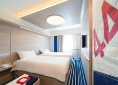 拉罗谢尔市中心宜必思尚品酒店 - 拉罗谢尔 - 睡房