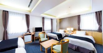 新大阪酒店 - 大阪 - 睡房