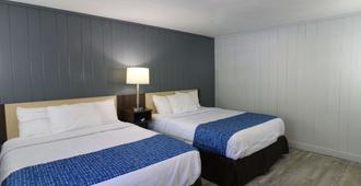 加特林堡市中心温德姆旅游旅馆 - 加特林堡 - 睡房