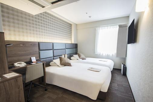 心斋桥赫顿酒店 - 大阪 - 睡房