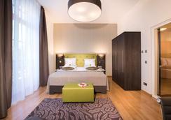 克雷吉姆利奥尼姆酒店 - 波恩(波昂) - 睡房