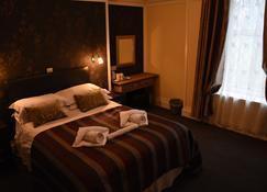 市场酒店 - 道格拉斯城堡 - 睡房
