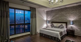 娄玛吉酒店及套房 - 麦纳麦 - 睡房