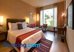 马拉萨纳萨诺瓦尊贵酒店 - 蒂鲁伯蒂 - 睡房