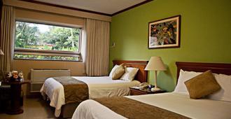 皇家卡米诺马拿瓜全球酒店 - 馬拿瓜