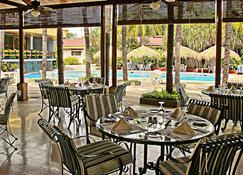 皇家卡米诺马拿瓜全球酒店 - 馬拿瓜 - 餐馆