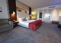 极乐温泉酒店 - 利默里克 - 睡房