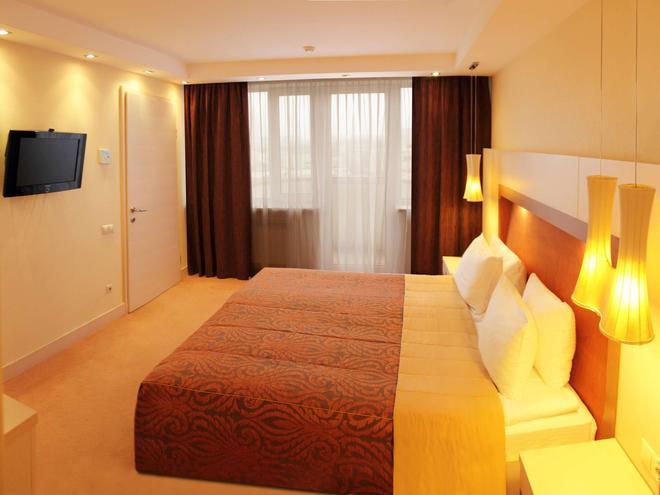总统大酒店 - 基辅 - 睡房