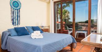 波萨达埃尔维亚杰罗酒店 - 科洛尼亞德爾薩克拉門托 - 睡房
