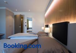 哈尔丁餐厅酒店 - 伯尔尼 - 睡房