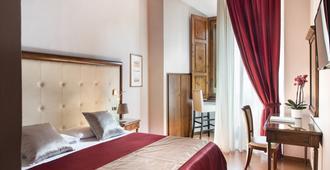 圣吉米尼亚诺利昂比安科酒店 - 圣吉米纳诺 - 睡房