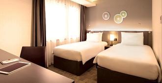 奥克伍德新大阪本公寓酒店 - 大阪 - 睡房