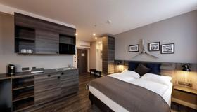 柏林安德尔斯霍夫机场酒店 - 柏林 - 睡房