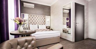 精品公寓酒店 - 基辅 - 睡房