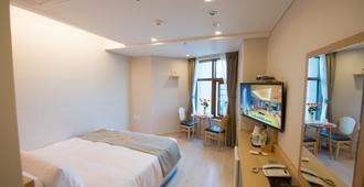 本昵客雅Premier Marianne酒店 - 釜山 - 睡房