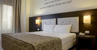 锡耶纳行政酒店 - 锡耶纳 - 睡房