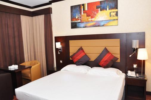 斯特朗德酒店 - 阿布扎比 - 睡房