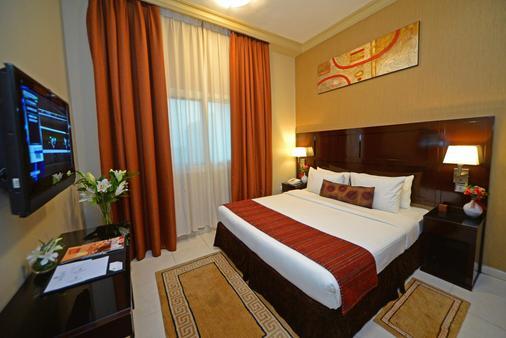 阿联酋星级公寓酒店 - 迪拜 - 睡房