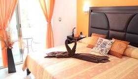 昆塔海滩家庭旅馆 - 卡门海滩 - 睡房