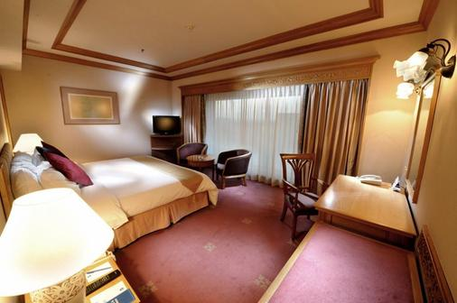普特里侧翼酒店 - 河滨壮丽 - 古晋 - 睡房