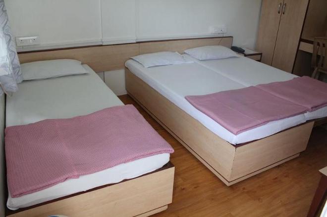斧山酒店 - 浦那 - 睡房