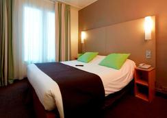钟楼巴黎14玛娜巴纳斯峰酒店 - 巴黎 - 睡房