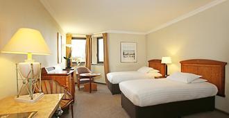 巴黎戴高乐千禧酒店 - 鲁瓦西昂法兰西 - 睡房