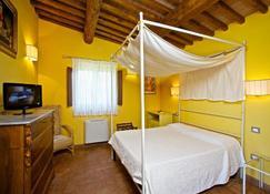 勒邱瑟农庄酒店 - 曼恰诺 - 睡房