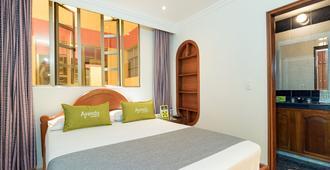阿因达 1071 号峰提崩酒店 - 波哥大 - 睡房