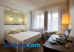 阿尔玛多莫斯酒店 - 锡耶纳 - 睡房