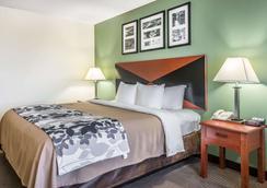 尚兹大学司丽普套房酒店 - 盖恩斯维尔 - 睡房
