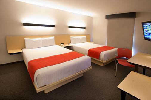 提华纳伊苏格特斯城市快捷酒店 - 提华纳 - 睡房