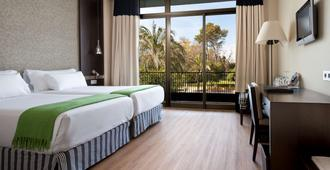 Nh阿维尼达赫雷斯酒店 - 赫雷斯-德拉弗龙特拉 - 睡房