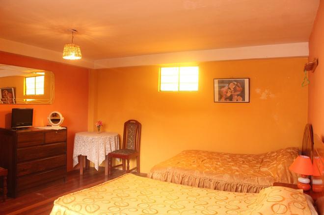 卡萨德玛玛2号酒店 - 库斯科 - 睡房