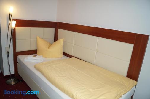 莱比锡米特城市酒店 - 莱比锡 - 睡房